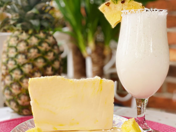 Photo of Pina Colada Fudge with a Pina Colada drink and a Pineapple